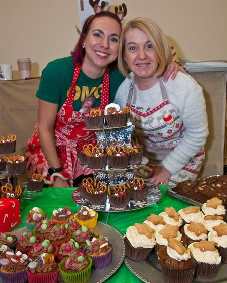 Emma Brown and Laura Shields selling cakes at St Francis School Christmas fair. Picture: MARK ATH