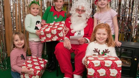 Father Christmas and friends at St Francis School Christmas fair. Picture: MARK ATHERTON