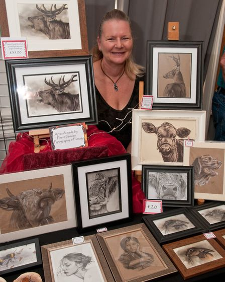 Ruth Baker with her pyrography art at Barley Wood Christmas Fair, Wrington. Picture: MARK ATHERTO