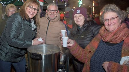 Wayne Hill and Tracy Taylor of Broad St. Hair Salon serving up mulled wine at Congresbury Broad Stre