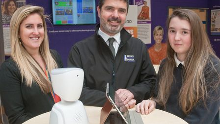 Makayla Nunn (right) with Priory principal Angelos Markoutsas and Daz the robot. Picture: MARK ATHE