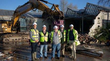 Tom Sheppard (far left) and Jeremy Drew (far right) of Newland Homes, with volunteers from Claverham