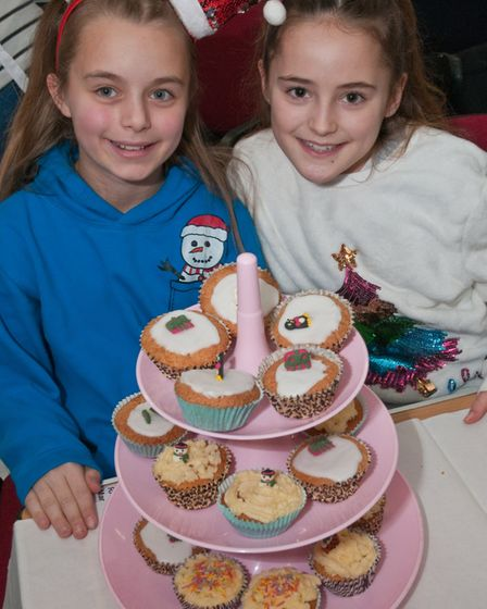 Anna and Neve seling cakes at Uphill Christmas Bazaar. Picture: MARK ATHERTON