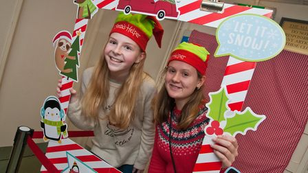 Elves Eve and Hannah welcoming visitors to Uphill Christmas Bazaar. Picture: MARK ATHERTON