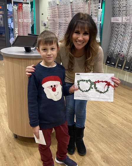 Specsavers colouring competition winner Arthur Hollis with Linda Lusardi