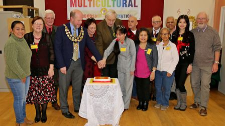 Guests cut the cake at the group's meeting. Picture: John Scaife
