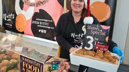 Louise Nutt selling her prize winning Scotch Eggs at eat:Christmas festival. Picture: MARK ATHERT