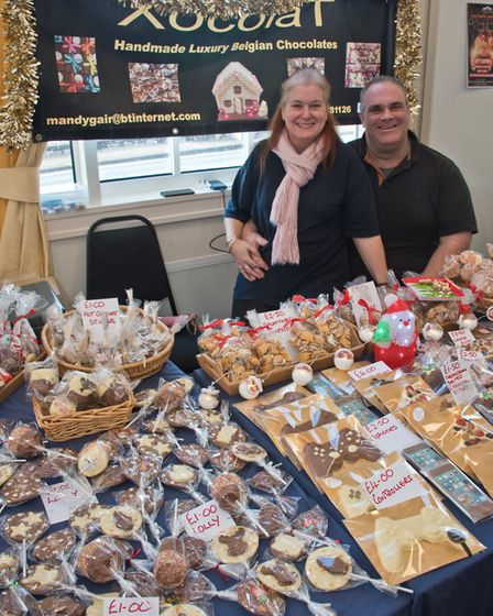 Mandy and Mark Gair with Xocolat at eat:Christmas festival. Picture: MARK ATHERTON