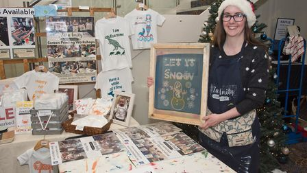 Zara Emily screen printer at eat:Christmas festival. Picture: MARK ATHERTON