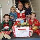 Children at The Nursery with the items they donated over Advent. Picture: Tracey Fowler