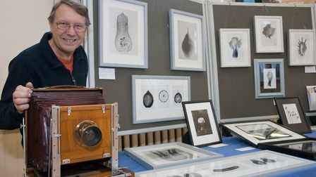 Photographer Simon Williams with his antique camera used to create unique images. Picture: MARK A