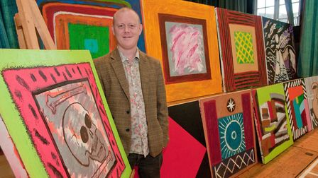 Artist Michael Bury proudly stands besides his creations at Wrington arts fair. Picture: MARK ATH