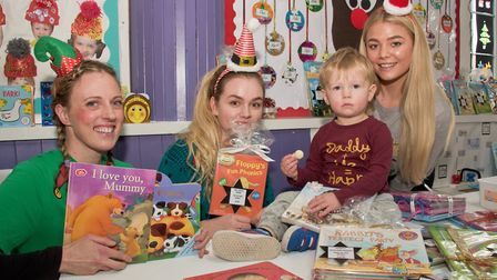 Staff selling donated books at the Christmas fair at Inwood Nursery, Congresbury. Picture: MAR