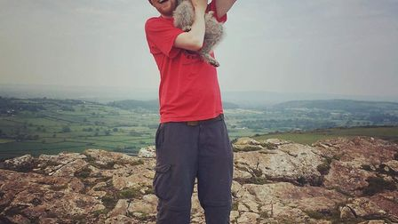 Joshua with his dog Grayson.