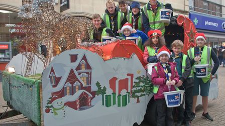 Members of the 1st Milton Scout group with their sleigh in Wston High Street. Picture: MARK AT