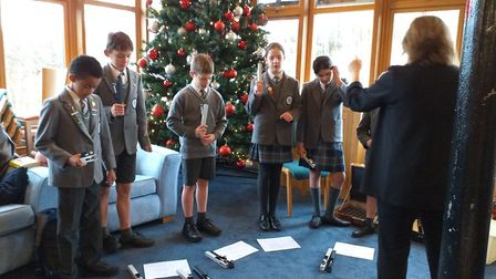 Fairfiled School students playing hand bells at a Christmas concert held at Charlton Farm children's