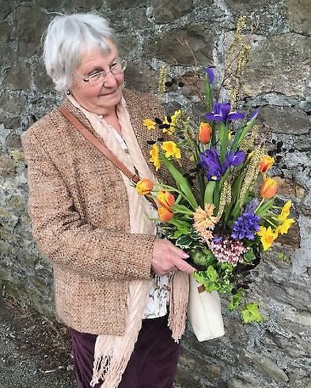 Ros Mizen with her prize winning floral art.Picture: Mark Atherton
