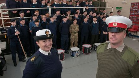 Warrant officer Phil Hawkins with T.S. Weston petty officer Divinia Tippett and cadets, officers and