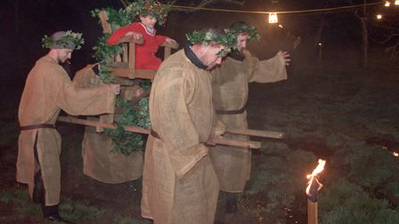 Apple Queen 6-year-old Piper being carried around the orchard by the burley men of Somerset to put t