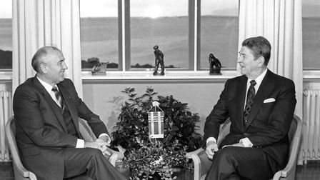 Mikhail Gorbachev and Ronald Reagan pose for photographers before talks begin in Reykjavik. Picture: