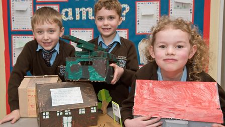 Year3 pupils from St Francis Primary School with models they have made for a local history museum in