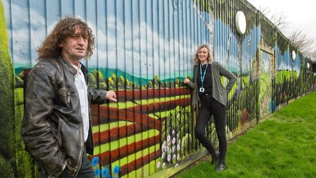 Artist Martin Darcy pictured with his mural and Kate Simmonds senior occupational therapist at the L