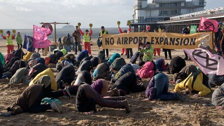 Over 100 Extinction Rebellion protestors on Weston beach putting their heads in the sand. Pict