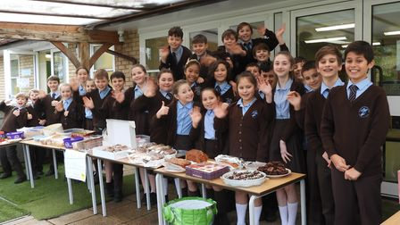 Year six pupils from St Francis Primary School holding a cake sale.