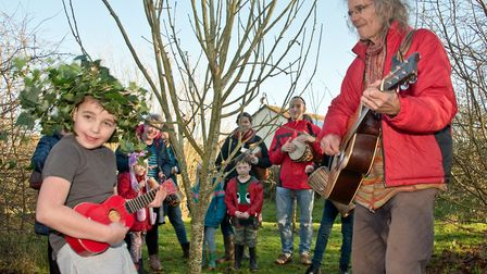 Long Ashton Wassail. Bill Roberts and Wassail King 7-year-old Ronnie singing to the apple trees. P