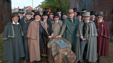 The Owls of Pill unveiling a plaque marking their 100th anniversary under the railway arch at Watchh