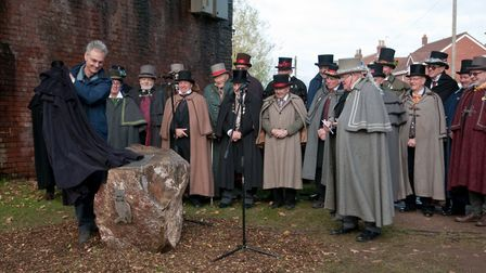 Owls of Pill marking their 100th anniversary with plaque unveiling by Donald Davies under the railwa