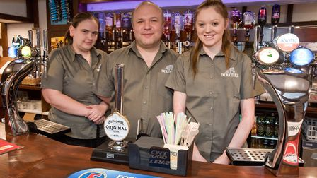 Manager Christopher Griggs with staff Sarah Staley and Jessica Lockner. Picture: MARK ATHERTON