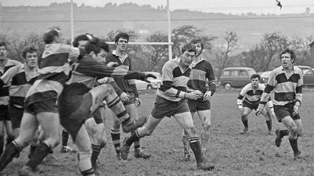 Hornets forward Ken Harrhy gets in a quick, clearing kick after a line-out in the game with Welsh si