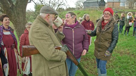 Sharing the Friendship Cup at Blagdon Wassail in the Community Orchard. Picture: MARK ATHERTON