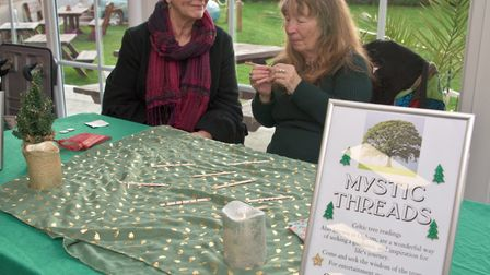 Marie from Mystic Threads giving Ogam, Celtic tree readings at the Winter Festival of Love and Light