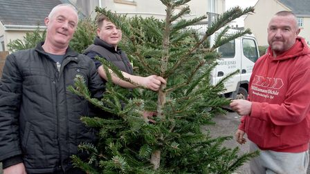 Jeff Gunton and friends Lee O'Dea and Dave Jones loading up a truck full of christmas trees donated