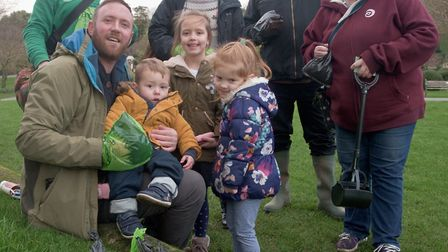 James Willis-Bowden with children Felicity, Bethany and Harvey, and volunteers clearing dog-poo from