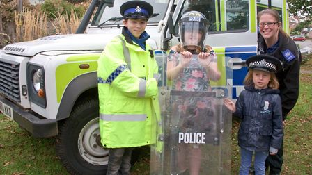 PCSO Julie Berchall with Lewis, Chloe and Lacey. Picture: MARK ATHERTON