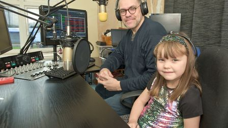 The youngest radio presenter in Weston Teyla Hopkins with her father Gary at Wave Community Radio.