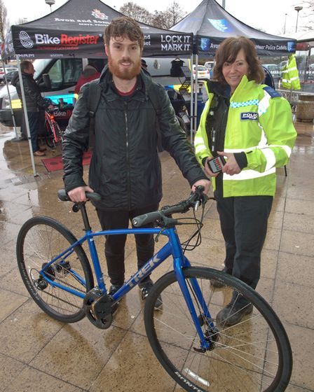 Mercury reporter Henry Woodsford having his bicycle security marked by PCSO's Kayley. Picture: MAR