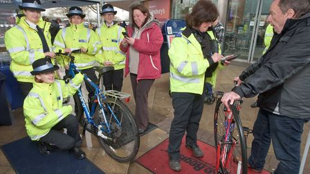 Officers from the police beat team carrying out free security markings of bike frames at Sainsburys