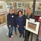 Sue Bryant, Philli Joyner, Lina Volpe, Joanna Gardener and Gill Leigh with members work.
