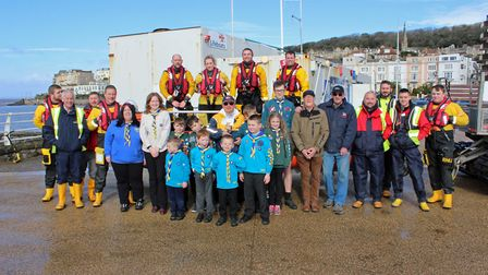 Members of 1st Miilton Scouts handing donating the cash to Weston RNLI.
