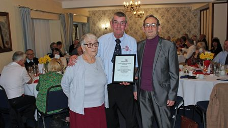 Jeff and Betty presented with a certificate from the RNLI.
