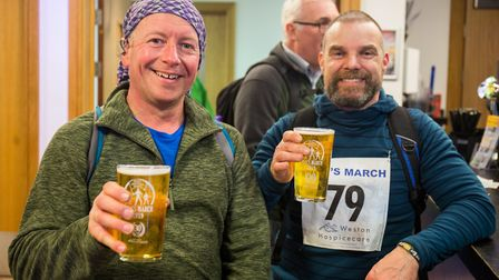 Walkers enjoying a pint of Thatchers after the march.