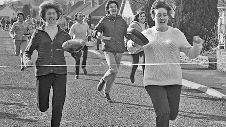 Cleeve WI's annual pancake race. Mrs. Lynette Lewis is first home in the open event. Picture: W