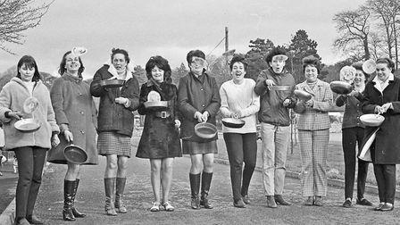 Cleeve WI's annual pancake race. Members are seen having a toss-up before the start. Picture: WE