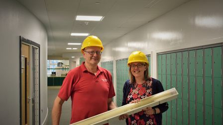Site manager William Carpenter and headteacher Dionne Elliott, with the old style florescent strip l