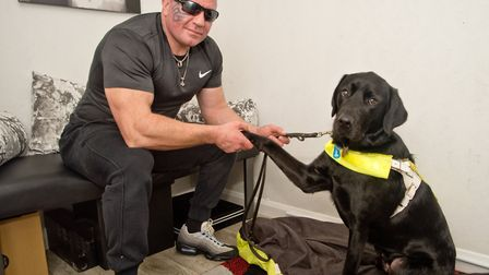 Visually impaired man Darren Palmer treated unfairly by pure gym, pictured with his guide dog. P