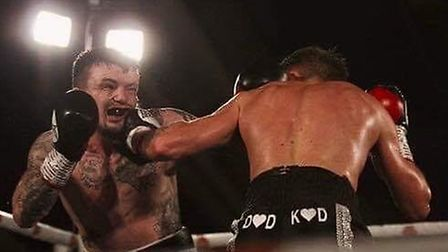 Dean Dodge lands one of his punches during his fight with Sean Davis.